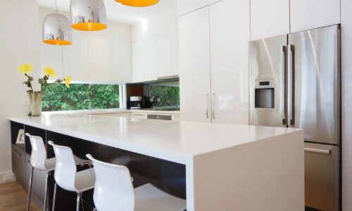 Modern Australian kitchen renovation with waterfall stone island bench